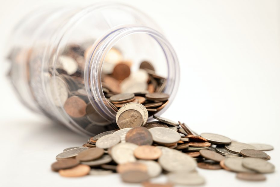 money coming out of a jar to denote finance and investmentt